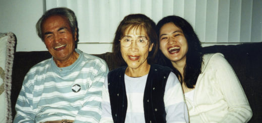 long distance caregiver Emi Gusukuma and her parents Yuki and Gus sitting on the couch