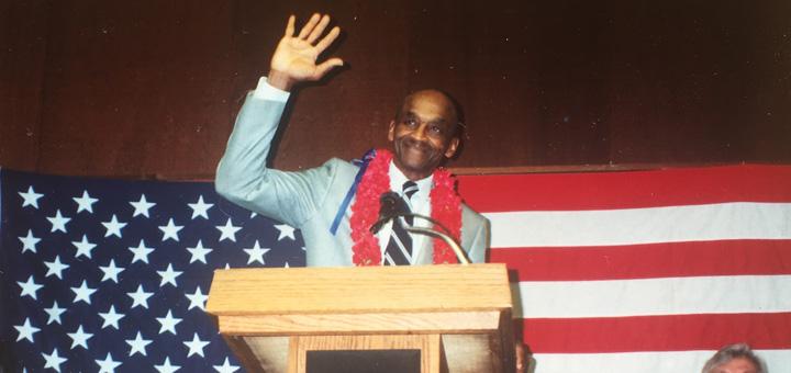 Howard Colston waves as he retires from career as Davis postal worker