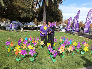 Teri poses with a yellow flower, honoring her grandma, Rachel, at the Solano County Walk to End Alzheimer's