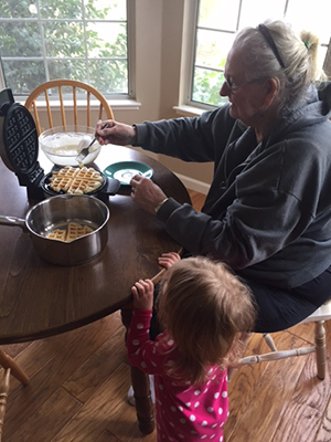 Bonnie who is living with Alzheimer's makes waffles with her granddaughter