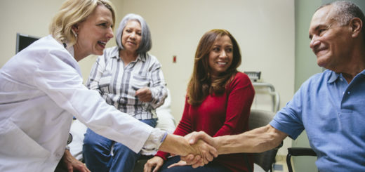Primary Care doctor shaking hands with caregiver