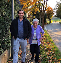 Volunteer Ben walks with his Oma who has Alzheimer's