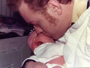 Bruce Pasternack kisses his new baby Joanne