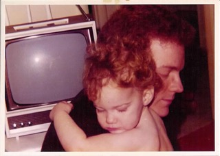 Joanne as a child hugs her dad Bruce