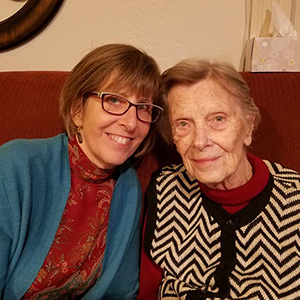 Volunteer Sharon poses with her mom living with Alzheimer's