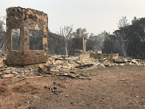 Smoking remains of Kirsten Guanella's home after the Tubbs fire