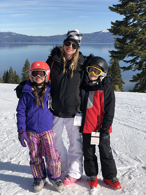 Kirsten Guanella and her children skiing