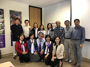 Alex poses with the first group of Mandarin speaking community educators