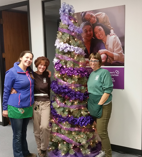 Lori Ann stands in front of the Christmas tree she donates to the Alzheimer's Association