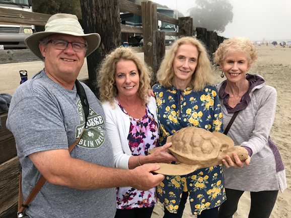 Sarah and her siblings hold the turtle urn they bought for their mom who died with Alzheimer's