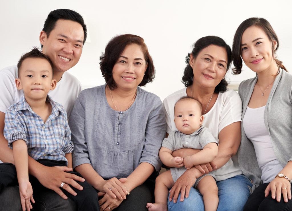 Asian family smiling at camera