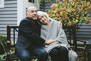 Woman with Alzheimer's and husband looking worried about palliative care