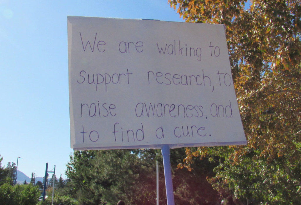 A sign at the 2019 Reno Walk to End Alzheimer's that says they support research