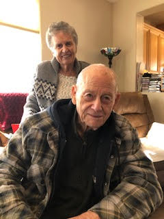 Andy and Phyllis pose in their memory care facility and both live with dementia