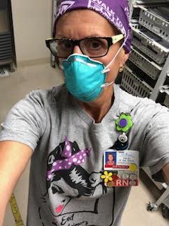ER Nurse Margo wears Alzheimer's flower pins she sells as a fundraiser