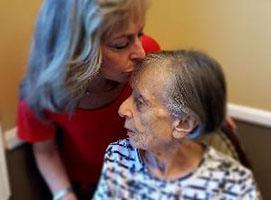 Nancy kisses her mom Helen who is living with Alzheimer's