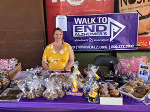 Summerfield staff have a bake-sale for Walk to End Alzheimer's fundraiser