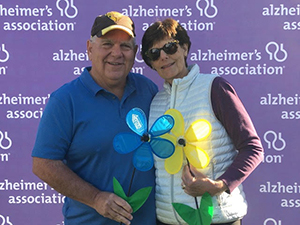 Wally and Pat hold promise flowers at Walk to End Alzheimer's