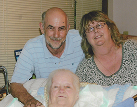 Terry and John pose with Margie who was had Alzheimer's
