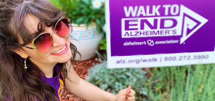 Barbara poses with her Walk to End Alzheimer's yard sign