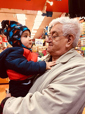 Lizandro who has dementia, holds his 3 year old grandson