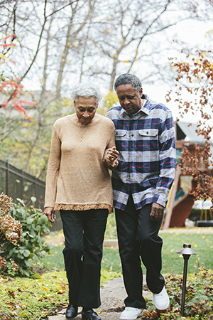 Husband and wife with Alzheimer's walk together