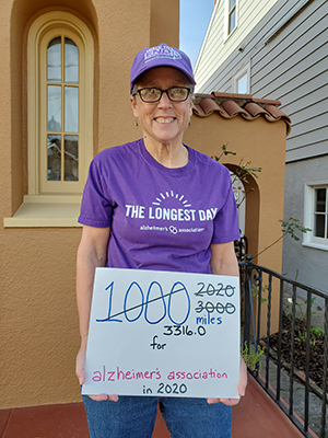 Sharon and her sign of how many miles she walked for Alzheimer's Assocation