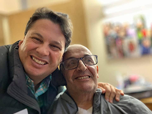 Celebrating his 70th birthday, Jason hugs his dad who is living with Alzheimer's