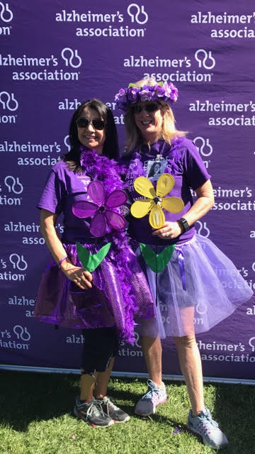 Pina and Lisa pose with promise flowers for the Walk to End Alzheimer's
