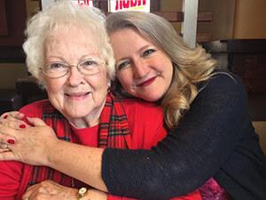 Karen DeHart hugs mother living with Alzheimer's